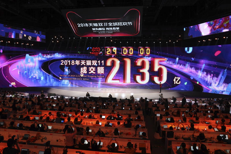 The final tally for Alibaba's 11.11 Global Shopping Festival also known as Singles Day is shown on screen as its passes midnight to set a new record of RMB213.5 billion or more than US$30 billion in Shanghai, China, Monday, Nov. 12, 2018. The spending binge has for years eclipsed Cyber Monday in the U.S. for online purchases made on a single day. This year's tally breaks from gloomy forecasts about the world's second-largest economy, which is struggling with a tariff war with the U.S., a stock market slump and slowing overall growth. (AP Photo/Ng Han Guan)
