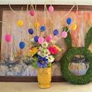 """<p>This might just be the most cheerful Easter egg tree around thanks to a bright bouquet of artificial blooms. </p><p><strong>Get the tutorial at <a href=""""https://www.dreamalittlebigger.com/post/easter-tree-tutorial.html"""" rel=""""nofollow noopener"""" target=""""_blank"""" data-ylk=""""slk:Dream A Little Bigger"""" class=""""link rapid-noclick-resp"""">Dream A Little Bigger</a>. </strong></p>"""