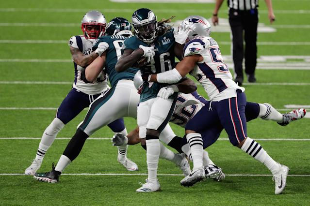 <p>Jay Ajayi #36 of the Philadelphia Eagles is tackled by Elandon Roberts #52 of the New England Patriots during the first quarter in Super Bowl LII at U.S. Bank Stadium on February 4, 2018 in Minneapolis, Minnesota. (Photo by Streeter Lecka/Getty Images) </p>