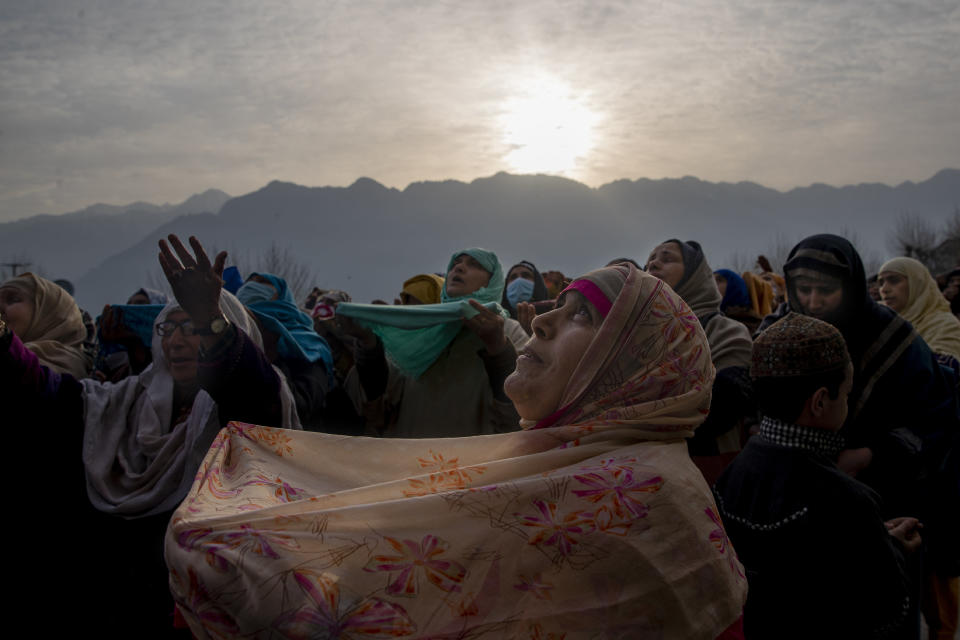 Kashmiri Muslim devotees pray as the head priest displays a relic believed to be a hair from the beard of Islam's Prophet Muhammad at the Hazratbal shrine on the Friday following Mehraj-u-Alam, believed to mark the ascension of Prophet Muhammad to heaven, in Srinagar, Indian controlled Kashmir, Friday, March 19, 2021. (AP Photo/Dar Yasin)