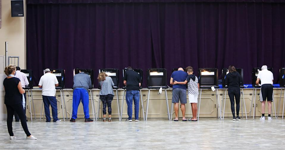 Miami Shores voters fill in their ballots at the C. Lawton McCall Community Center on Election Day, November 3, 2020. (Emily Michot/Miami Herald/Tribune News Service via Getty Images)