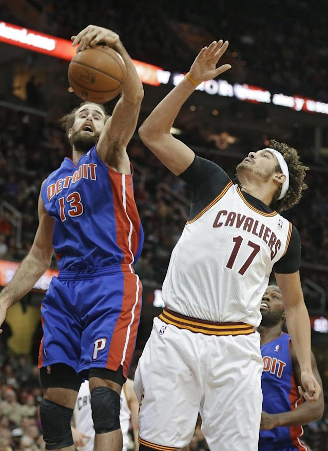 Detroit Pistons' Luigi Datome (13), from Italy, tries to grab a rebound against Cleveland Cavaliers' Anderson Varejao (17), from Brazil, during the second quarter of an NBA basketball game Monday, Dec. 23, 2013, in Cleveland. (AP Photo/Mark Duncan)