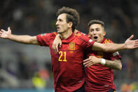 Spain's Mikel Oyarzabal, left, celebrates with teammate Spain's Yeremi Pino after scoring during the UEFA Nations League final soccer match between France and Spain at the San Siro stadium, in Milan, Italy, Sunday, Oct. 10, 2021. (AP Photo/Luca Bruno)