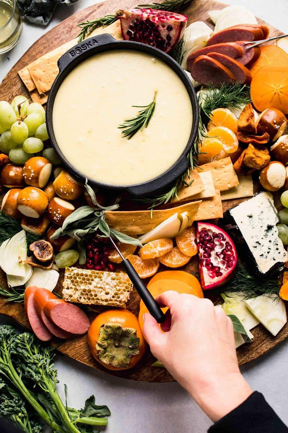 "<p>Want to make the cheesiest and easiest fondue? This recipe is just what you need. Just grab a fondue pot and get excited! You can pair this recipe with everything from ripe pears to toasted ravioli. </p> <p><strong>Get the recipe</strong>: <a href=""https://www.platingsandpairings.com/classic-cheese-fondue-recipe/"" class=""link rapid-noclick-resp"" rel=""nofollow noopener"" target=""_blank"" data-ylk=""slk:smoky three-cheese fondue with toasted garlic buttered croissants"">smoky three-cheese fondue with toasted garlic buttered croissants</a></p>"