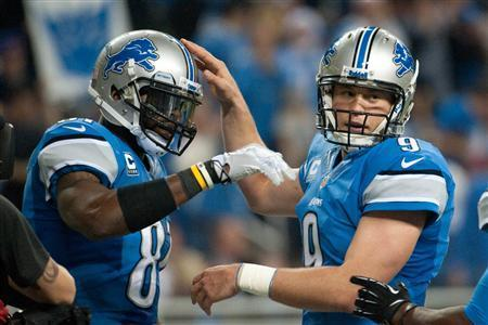 Detroit Lions wide receiver Calvin Johnson (81) celebrates his touchdown with quarterback Matthew Stafford (9) during the third quarter against the Green Bay Packers during a NFL football game on Thanksgiving at Ford Field. Mandatory Credit: Tim Fuller-USA TODAY Sports