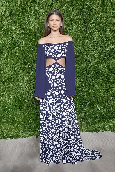 <p>Zendaya wore a navy off-the-shoulder Michael Kors Collection dress, which featured floral embellishments and cutouts at the waist. The actress, who just launched her own clothing line, was on hand to introduce Kors for his keynote speech at the show. (Photo: Getty Images) </p>