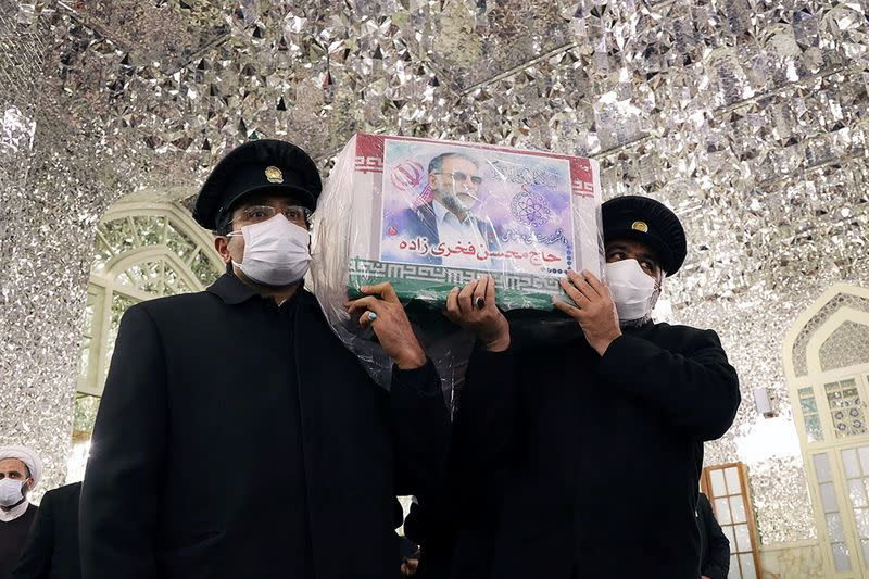 Servants of the holy shrine of Imam Reza carry the coffin of Iranian nuclear scientist Mohsen Fakhrizadeh, in Mashhad