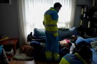 The Wider Image: 'The best job in the world': a Madrid ambulance doctor's dedication after a year of COVID