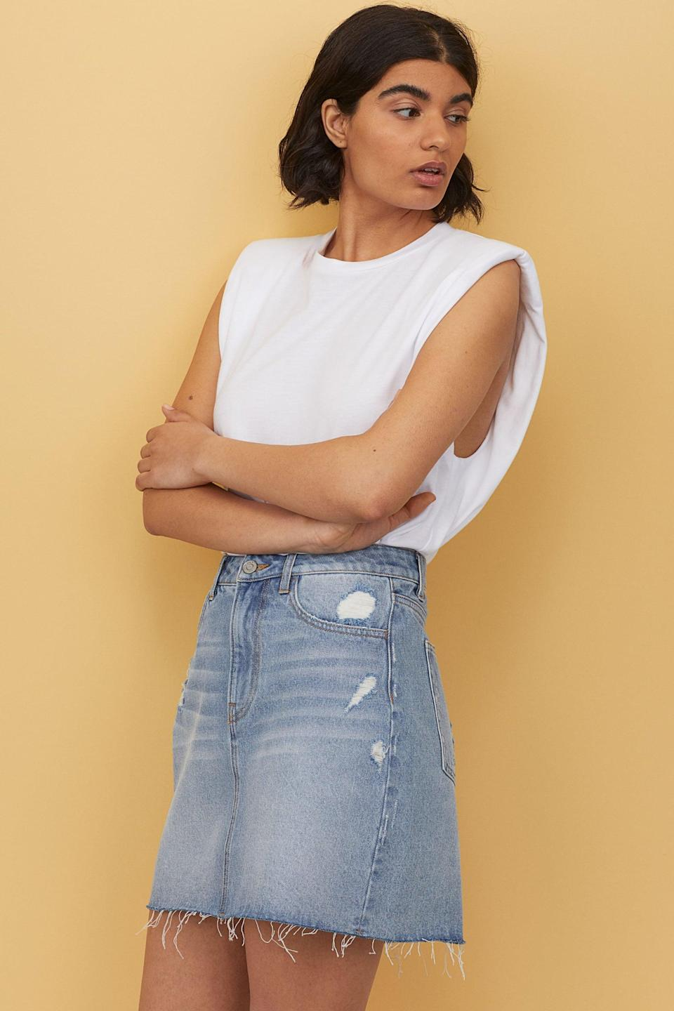 "<p>You can wear this <a href=""https://www.popsugar.com/buy/HampM-Denim-Skirt-581994?p_name=H%26amp%3BM%20Denim%20Skirt&retailer=www2.hm.com&pid=581994&price=20&evar1=fab%3Aus&evar9=35329485&evar98=https%3A%2F%2Fwww.popsugar.com%2Ffashion%2Fphoto-gallery%2F35329485%2Fimage%2F47550200%2FHM-Denim-Skirt&list1=shopping%2Cdenim%2Csummer%20fashion%2Cfashion%20shopping&prop13=mobile&pdata=1"" class=""link rapid-noclick-resp"" rel=""nofollow noopener"" target=""_blank"" data-ylk=""slk:H&amp;M Denim Skirt"">H&amp;M Denim Skirt</a> ($20) so many ways.</p>"