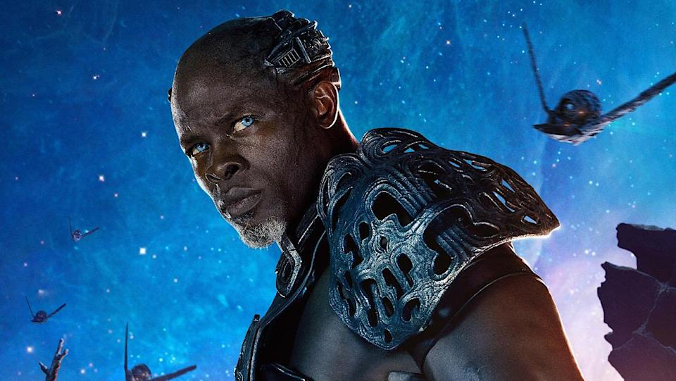 Djimon Hounsou with blue eyes and in armor on the poster of Guardians of the Galaxy.