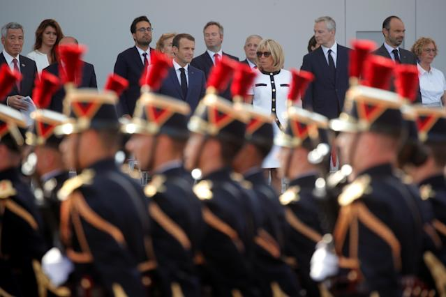 <p>French President Emmanuel Macron, his wife Brigitte Macron, Singapore's Prime Minister Lee Hsien Loong and members of the French government attend the traditional Bastille Day military parade on the Champs-Élysées in Paris, France, July 14, 2018. (Photo: Philippe Wojazer/Pool/Reuters) </p>
