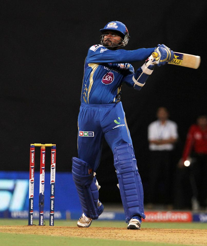 Mumbai Indian player Harbhajan Singh plays a shot during match 66 of the Pepsi Indian Premier League ( IPL) 2013  between The Mumbai Indians and the Rajasthan Royals held at the Wankhede Stadium in Mumbai on the 15th May 2013 ..Photo by Vipin Pawar-IPL-SPORTZPICS ..Use of this image is subject to the terms and conditions as outlined by the BCCI. These terms can be found by following this link:..https://ec.yimg.com/ec?url=http%3a%2f%2fwww.sportzpics.co.za%2fimage%2fI0000SoRagM2cIEc&t=1506275268&sig=k5CR8L8QNMCaonk9PmH8hQ--~D