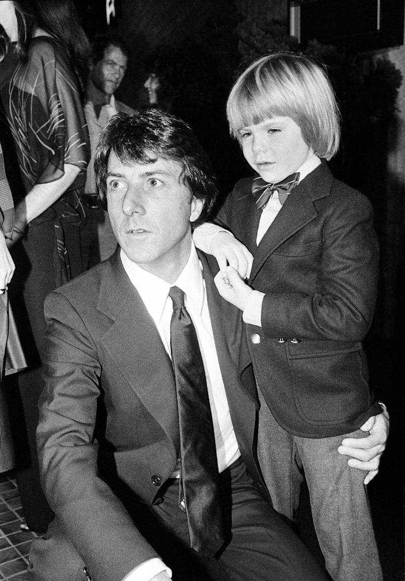 """FILE - In this December 5, 1979 file photo, actor Dustin Hoffman, left, and supporting actor, Justin Henry, 6, are seen at the premiere of their motion picture, """"Kramer vs. Kramer,"""" in Los Angles, Calif. Henry, who remains the youngest-ever Oscar nominee in any category for 1979's """"Kramer vs. Kramer,"""" said that in some ways it's a purer form of acting at this age. (AP Photo, File)"""