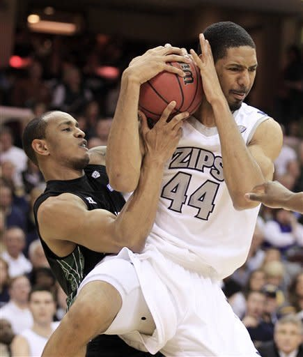 Ohio's Walter Offutt, left, and Akron's Zeke Marshall battle for a rebound in the first half of an NCAA college basketball championship game in the Mid-American Conference men's tournament Saturday, March 10, 2012, in Cleveland. (AP Photo/Tony Dejak)
