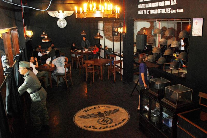 Nazi swastika insignia decorate the interior of the SoldatenKaffee (The Soldiers' Cafe) in Bandung city, Java island, Indonesia (AFP Photo/TIMUR MATAHARI)