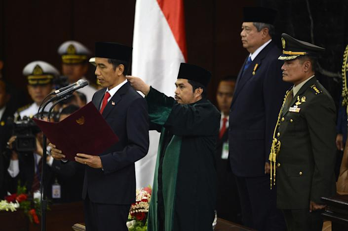 Joko Widodo is sworn-in as Indonesian president during the inaugural ceremony at the House of Representative in Jakarta, on October 20, 2014 (AFP Photo/Romeo Gacad)