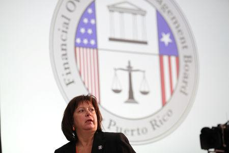 FILE PHOTO - Natalie Jaresko, Executive Director of the Federal Fiscal Control Board of Puerto Rico attends a meeting of the Financial Oversight and Management Board for Puerto Rico at the College of Engineers and Land Surveyors in San Juan, Puerto Rico October 31, 2017. REUTERS/Alvin Baez