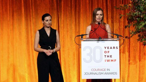 PHOTO: Honorees Ukrainian journalists Anna Babinets of SLIDSTVO.INFO and Nastya Stanko of Hromadske speak on stage during the International Women's Media Foundation's 2019 Courage in Journalism awards, Oct. 30, 2019, in New York City. (Bennett Raglin/Getty Images)