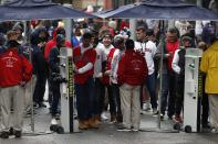 Fans line up to pass through security at the entrance to Fenway Park before a baseball game between the Boston Red Sox and the Miami Marlins, Saturday, May 29, 2021, in Boston. Saturday marks the end of most COVID-19 restrictions in Massachusetts. (AP Photo/Michael Dwyer)