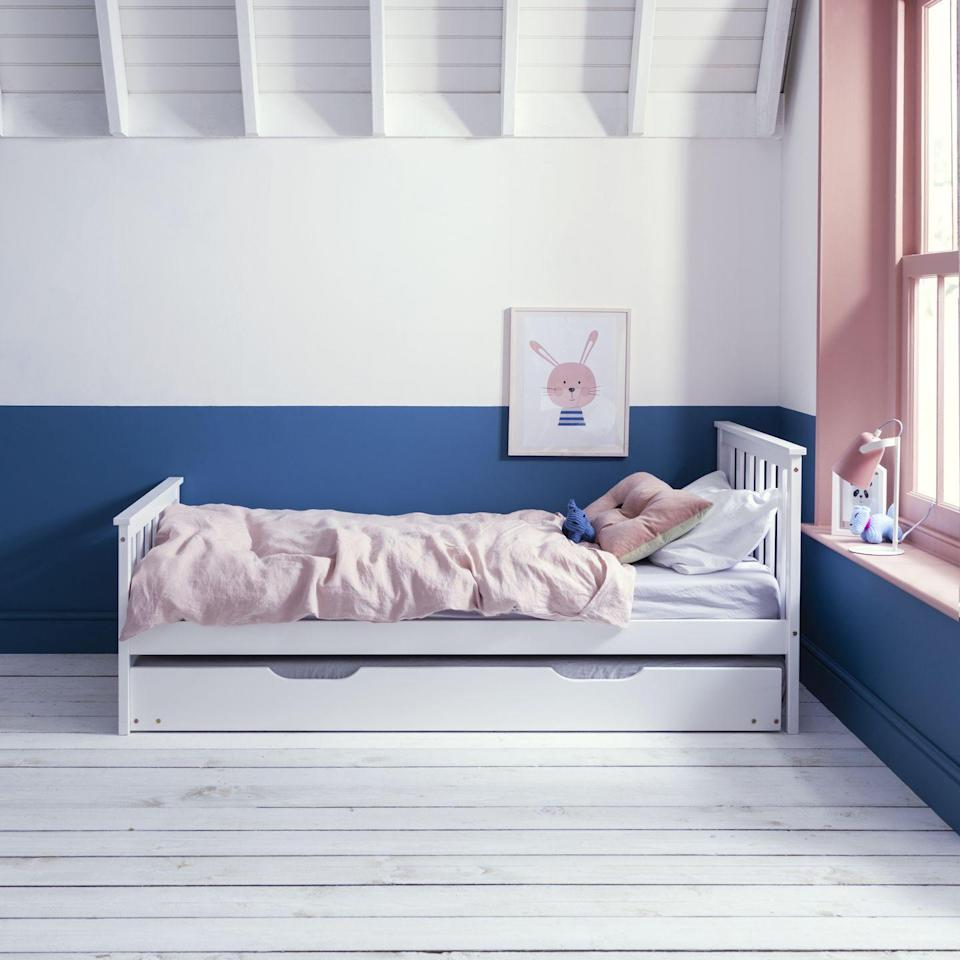 """<p>These days you can have loads of fun with paint as anything goes – literally! Painting the ceiling, painting the floor, stripes, spots, checks...the world really is your oyster. For this girls' bedroom idea we love the choice of three colours here. Royal Blue adds depth and doesn't take over due to the white, and that pretty pink on the window is an on-trend look right now. Who needs to paint their woodwork white? Not us!</p><p>Pictured: Dorset single bed with pull out space saver trundle, <a href=""""https://go.redirectingat.com?id=127X1599956&url=https%3A%2F%2Fwww.noaandnani.co.uk%2Fsingle-beds-c6%2Fsingle-kids-beds-c16%2Fdorset-single-bed-with-pull-out-spacesaver-trundle-in-classic-white-p1110&sref=https%3A%2F%2Fwww.housebeautiful.com%2Fuk%2Fdecorate%2Fbedroom%2Fg35589644%2Fgirls-bedroom-ideas%2F"""" rel=""""nofollow noopener"""" target=""""_blank"""" data-ylk=""""slk:Noa & Nani"""" class=""""link rapid-noclick-resp"""">Noa & Nani</a></p>"""