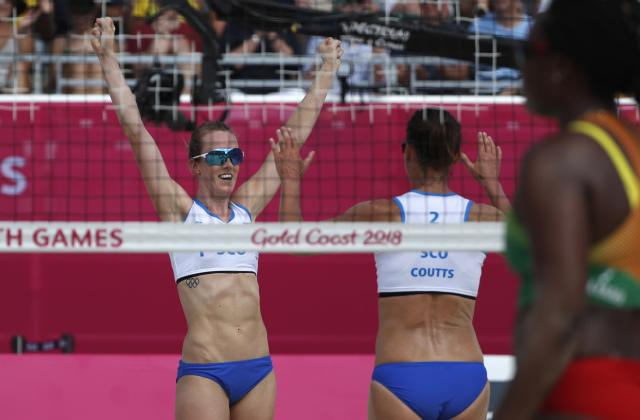 Beach Volleyball - Gold Coast 2018 Commonwealth Games - Women Preliminary - Pool A - Scotland v Grenada - Coolangatta Beachfront - Gold Coast, Australia - April 6, 2018. Lynne Beattie and Melissa Coutts of Scotland celebrate their win over Grenada. REUTERS/Paul Childs