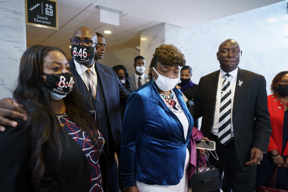 From left, Keeta Floyd, her husband Philonise Floyd, brother of George Floyd who was killed by Minneapolis police, Gwen Carr, mother of Eric Garner who was killed by a New York Police Department officer using a prohibited chokehold during his arrest, and civil rights attorney Ben Crump, who represented the family George Floyd, talk to reporters following a meeting with Sen. Tim Scott, R-S.C., who is working on a police reform bill in the Senate, at the Capitol in Washington, Thursday, April 29, 2021. (AP Photo/J. Scott Applewhite)