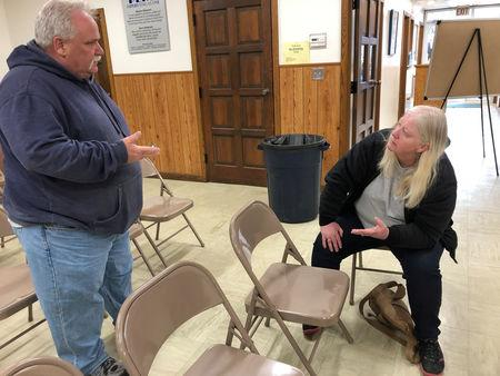 Jim and Rose Downing talk after losing their home in flood waters which caused deaths and hundreds of millions of dollars in damages, with waters yet to crest in parts of the U.S. midwest, in Peru, Nebraska, U.S., March 19, 2019.  REUTERS/Karen Dillon