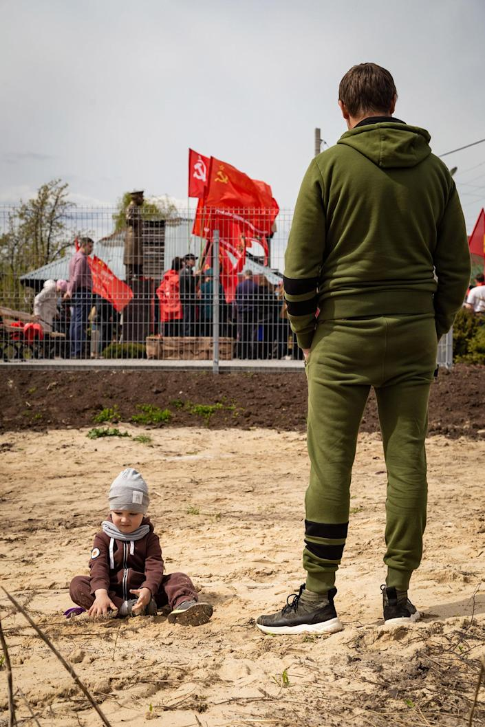 Image: People watch the laying the first stone in the foundations of the Stalin Center, Bor, Nizhny Novgorod (Anton Belousov / for NBC News)