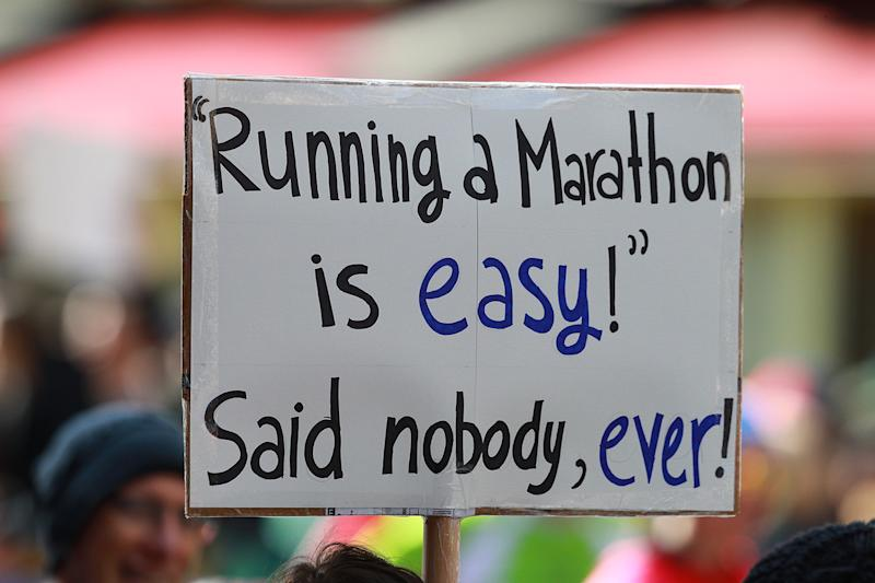 A spectator holds up a sign supporting runners during the New York City Marathon. (Photo: Gordon Donovan/Yahoo News)