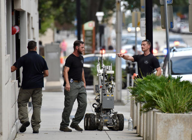 <p>Bomb squad police prepare a robot to enter a parking garage a block away from the scene of a multiple shooting at the Jacksonville Landing, Aug. 26, 2018, during a video game competition in Jacksonville, Fla. (Photo: Will Dickey/The Florida Times-Union via AP) </p>