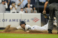 New York Yankees' Tyler Wade scores on a game winning RBI single by Aaron Judge during the ninth inning of a baseball game against the Tampa Bay Rays Sunday, Oct. 3, 2021, in New York. The Yankees won 1-0. (AP Photo/Frank Franklin II)