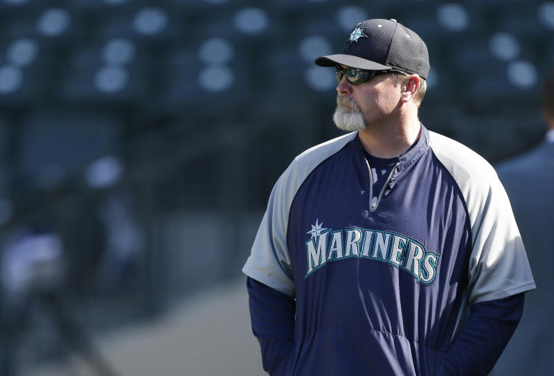 FILE - In this June 12, 2013 file photo, Seattle Mariners manager Eric Wedge watches batting practice before a baseball game against the Houston Astros in Seattle. Wedge suffered a dizzy spell during batting practice Monday, July 22, 2013, in Seattle, and was taken to a hospital as a precaution, and the Mariners announced that bench coach Robby Thompson would manage the team for Monday night's game against the Cleveland Indians. (AP Photo/Ted S. Warren, file)