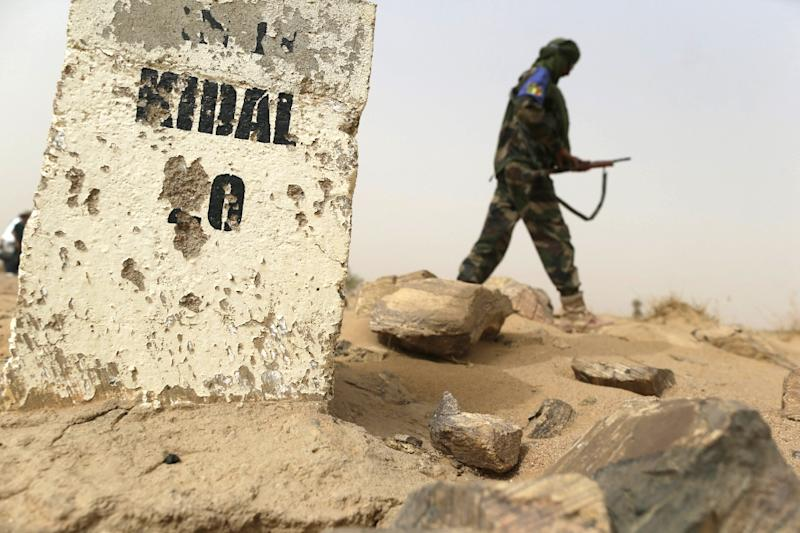 A soldier is seen patrolling a road between Gao and Kidal, in northern Mali, in 2013