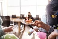 """<p>Birthdays, retirements and """"Bagel Fridays"""" abound if you work in an office environment. In fact, the average person consumes 1,277 calories each week by way of free work snacks alone, according to a report from the <a href=""""https://www.dropbox.com/s/via8rwd8nci7tfh/Onufrak_worksite%20foods%20%26%20beverages%20abstract.pdf?dl=0"""" rel=""""nofollow noopener"""" target=""""_blank"""" data-ylk=""""slk:Centers for Disease Control and Prevention (CDC)"""" class=""""link rapid-noclick-resp"""">Centers for Disease Control and Prevention (CDC)</a>. That adds up to an extra pound every three weeks, or a bonus 17 pounds for the year.</p><p>Once you set your get-fit goal, place a visible reminder at your desk. Then, share your wishes with a pal and ask them to be your accomplice. When a craving comes on, you can split that bagel or go for a walk instead of biting into another brownie.</p><p>""""Find a friend or co-worker to be your ally and hold you accountable. You shouldn't be alone in changing your habits. Find a squad to support you and do it together,"""" Werner says.</p>"""