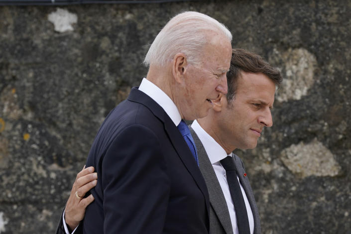 President Joe Biden speaks with French President Emmanuel Macron after posing for the G-7 family photo with guests at the G-7 summit, Friday, June 11, 2021, in Carbis Bay, England. (AP Photo/Patrick Semansky, Pool)