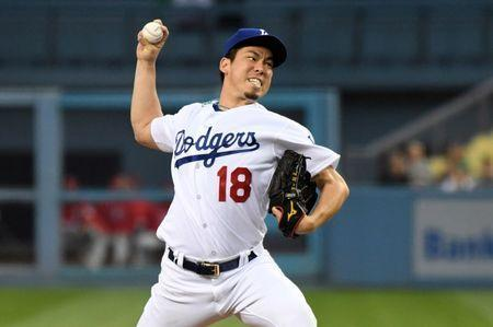 May 29, 2018; Los Angeles, CA, USA; Los Angeles Dodgers starting pitcher Kenta Maeda (18) delivers a pitch in the second inning against the Philadelphia Phillies at Dodger Stadium. Mandatory Credit: Kirby Lee-USA TODAY Sports