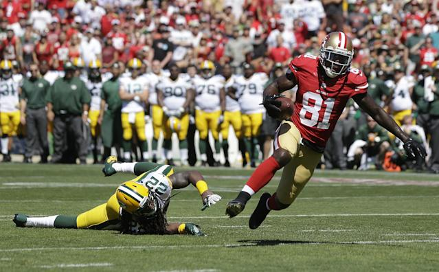 San Francisco 49ers wide receiver Anquan Boldin (81) scores on a 10-yard touchdown reception against past Green Bay Packers defensive back Jerron McMillian (22) during the second quarter of an NFL football game in San Francisco, Sunday, Sept. 8, 2013. (AP Photo/Marcio Jose Sanchez)