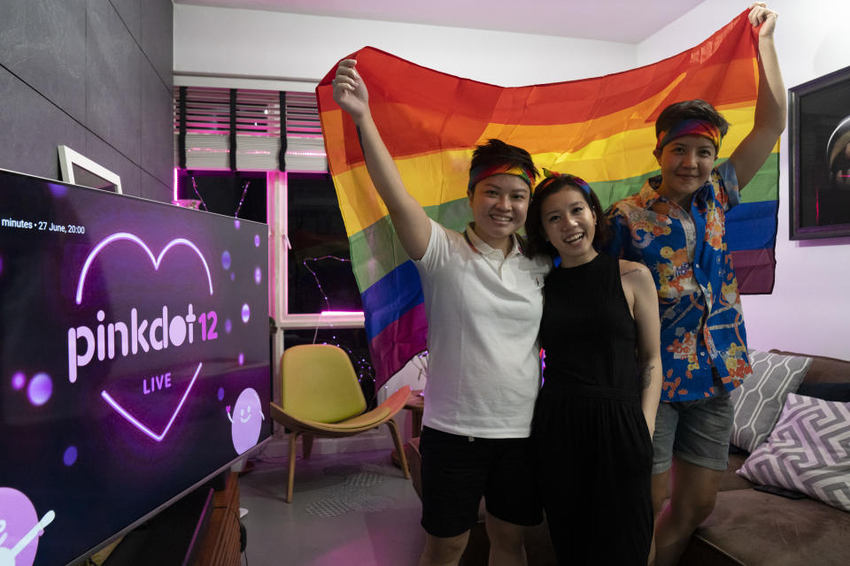 SINGAPORE, SINGAPORE - JUNE 27: A group of friends pose for a portrait holding up the Progress Flag to show support to the LGBTQ community on June 27, 2020 in Singapore. Due to the ongoing coronavirus pandemic, this years Pink Dot SG rally has gone online. (Photo by Ore Huiying/Getty Images)