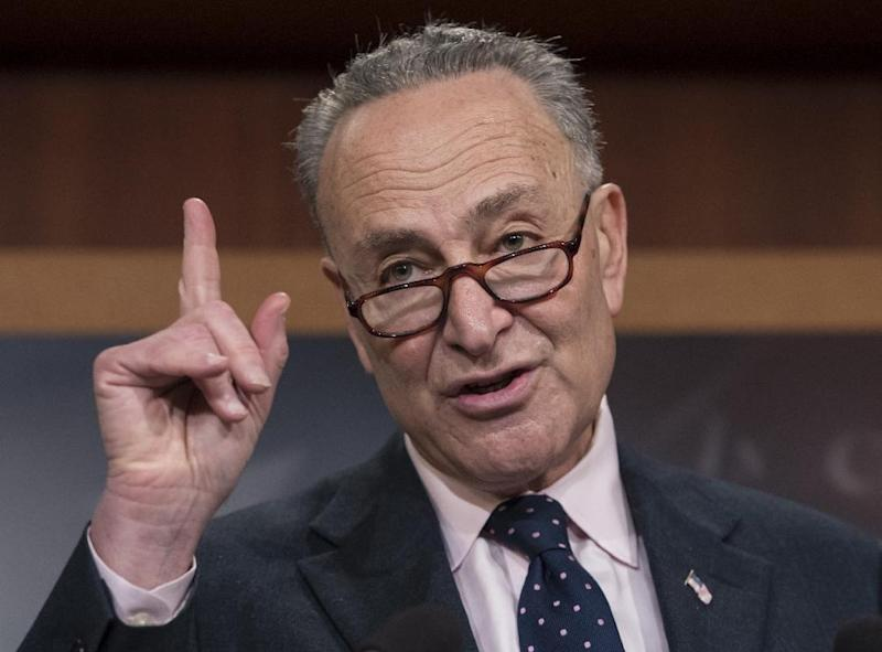 Schumer rallies with refugees in front of U.S