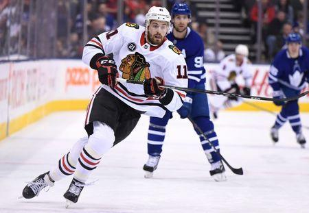 Mar 13, 2019; Toronto, Ontario, CAN; Chicago Blackhawks forward Brendan Perlini (11) pursues the play against Toronto Maple Leafs in the first period at Scotiabank Arena. Mandatory Credit: Dan Hamilton-USA TODAY Sports
