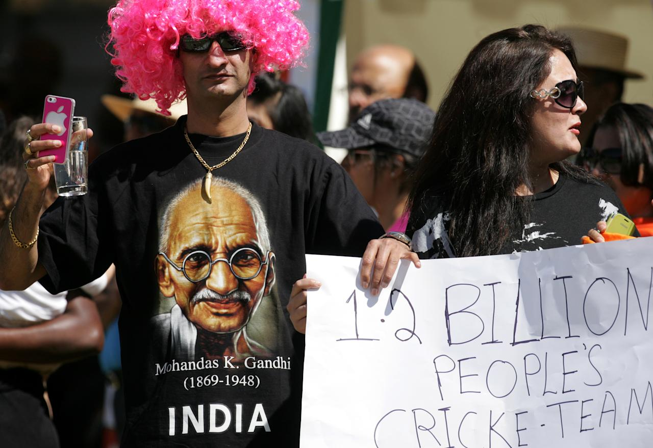 Indian cricket fans support their team during the 3rd match of the 5 match cricket ODI series between hosts Zimbabwe and India at Harare Sports Club on July 28 2013. AFP/PHOTO JEKESAI NJIKIZANA        (Photo credit should read JEKESAI NJIKIZANA/AFP/Getty Images)