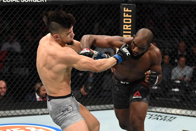 (R-L) Corey Anderson punches Johnny Walker in their light heavyweight bout during UFC 244 at Madison Square Garden on Nov. 2, 2019 in New York City. (Getty Images)