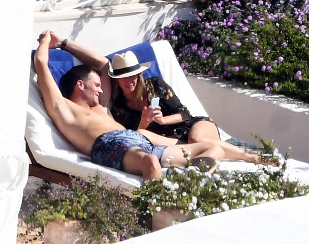 "<p>Gisele and Tom had no problem remembering that R&R means rest and relaxation. The couple worked on their tans while lounging side by side. The NFL star even <a href=""http://nypost.com/2016/09/26/how-is-brady-spending-the-deflategate-suspension-nude-sunbathing/"">dared to sunbathe in the nude</a>! (But if you're going to strip down a bit, make sure you have enough sunscreen.) (Photo: AKM-GSI)</p>"