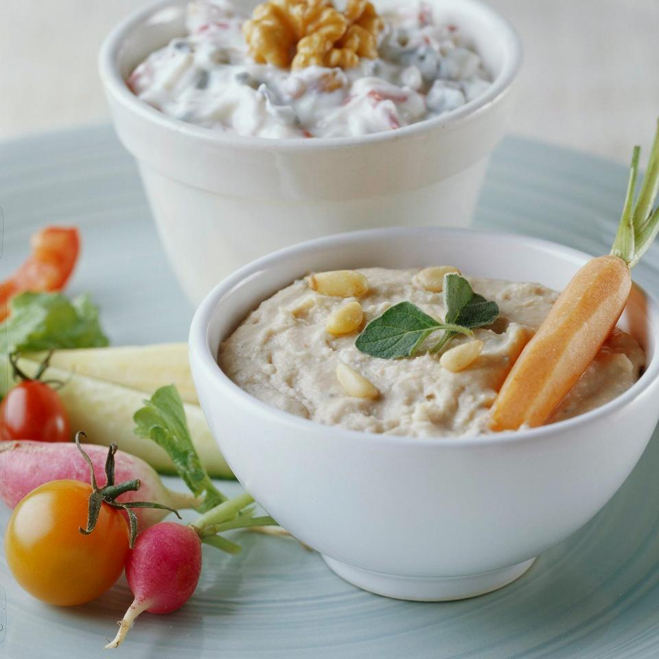 <p>Homemade yogurt cheese is the trick to this make-ahead party dip featuring feta cheese and zesty Mediterranean flavors. To make yogurt cheese, just drain yogurt of excess whey before use.</p>