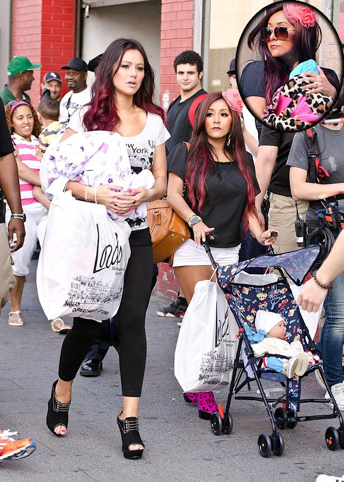 "Babies on board? Not exactly. ""Jersey Shore"" stars JWoww (left) and Snooki, who recently announced she's pregnant, practiced their parenting skills with plastic dolls while shooting their new reality show spin-off in Jersey City on Thursday. (3/22/2012)"
