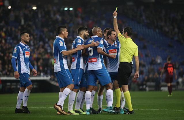 Soccer Football - Spanish King's Cup - Espanyol vs FC Barcelona - Quarter-Final - First Leg - RCDE Stadium, Barcelona, Spain - January 17, 2018 Espanyol's Gerard Moreno is shown a yellow card by referee Ricardo de Burgos Bengoetxea REUTERS/Albert Gea