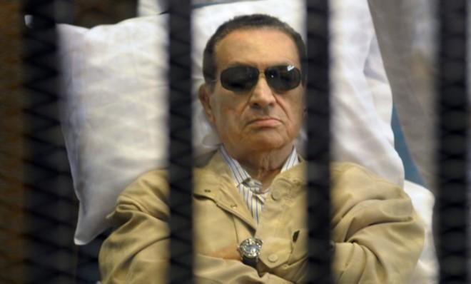 Hosni Mubarak lays on a gurney inside the police academy courthouse in Cairo on June 2, 2012.
