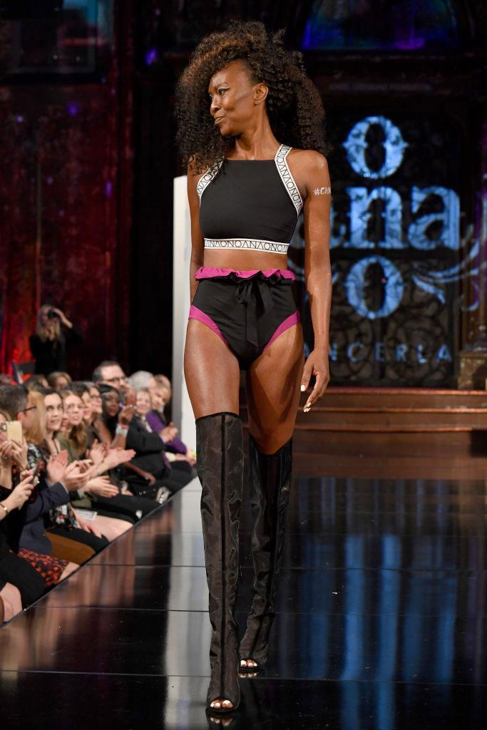 <p>Model wears a racer neck bra top and pink lined black panties at the AnaOno x #Cancerland show during NYFW. (Photo: Getty) </p>