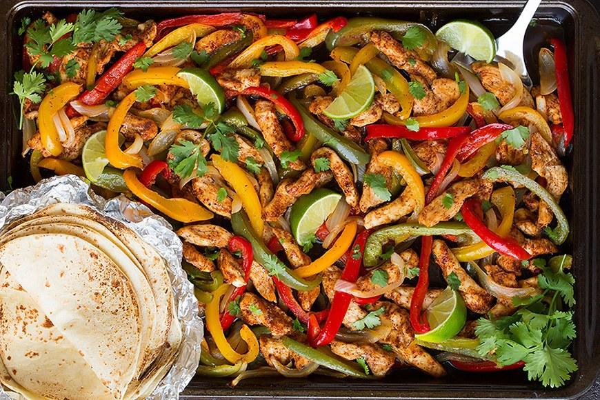 """<p>No, you don't need to spend hours sweating over a skillet to make great fajitas. This spin on the classic needs less than <a rel=""""nofollow"""" href=""""http://www.self.com/gallery/11-high-protein-wraps-you-can-make-in-30-minutes-or-less?mbid=synd_yahoofood"""">30 minutes in the oven</a>. Serve it with tortillas and fixings like sour cream and guacamole. Get the recipe <a rel=""""nofollow"""" href=""""http://www.cookingclassy.com/sheet-pan-chicken-fajitas?mbid=synd_yahoofood"""">here</a>.</p>"""