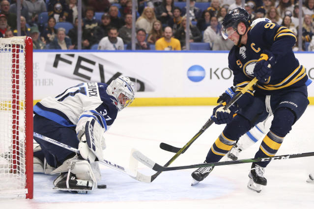 Buffalo Sabres forward Jack Eichel (9) is stopped by Winnipeg Jets goalie Connor Hellebuyck (37) during the first period of an NHL hockey game Sunday, Feb. 23, 2020, in Buffalo, N.Y. (AP Photo/Jeffrey T. Barnes)